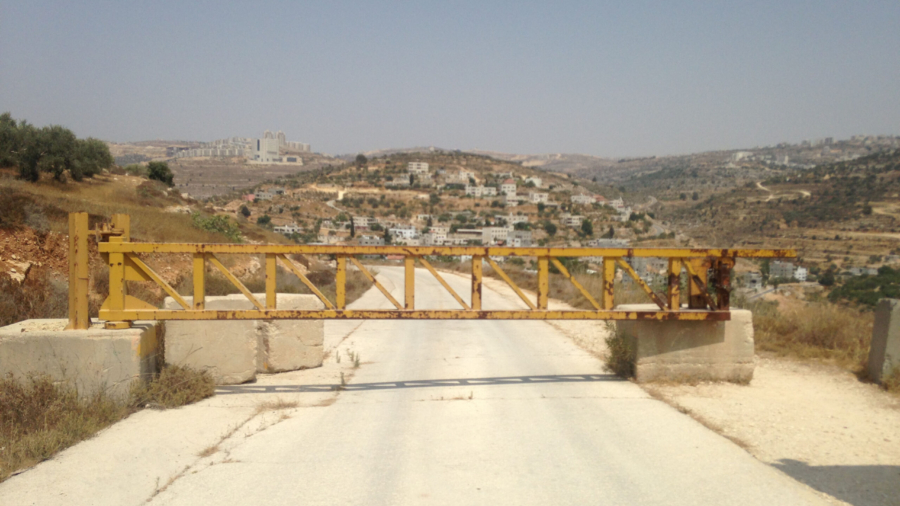 A road near the Israeli settlement of Dolev, where a gate blocks Palestinians from the nearby village of Ein Qinya from driving to the main road.